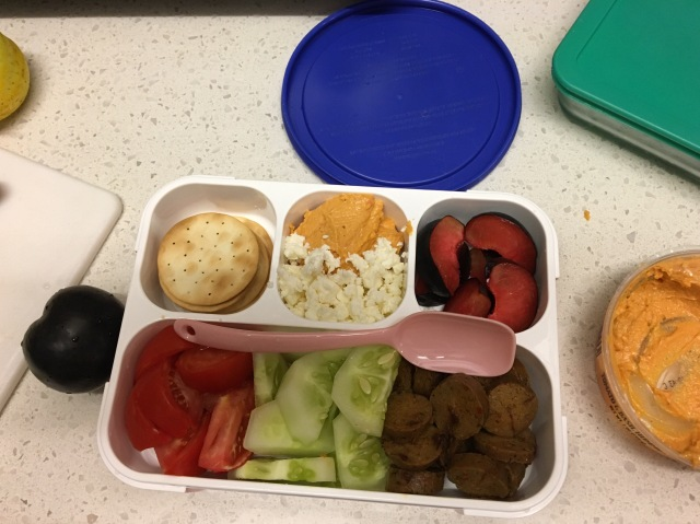 Open bento box with spoon